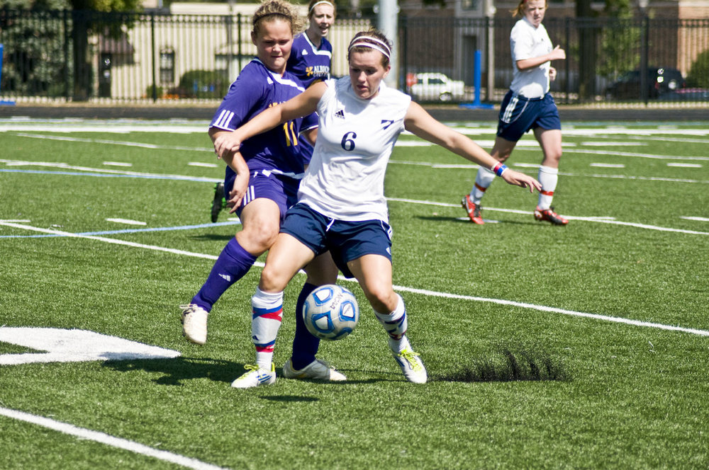 File Photo   Megan Mrazek battles with an Albion player at Langhorst Field.