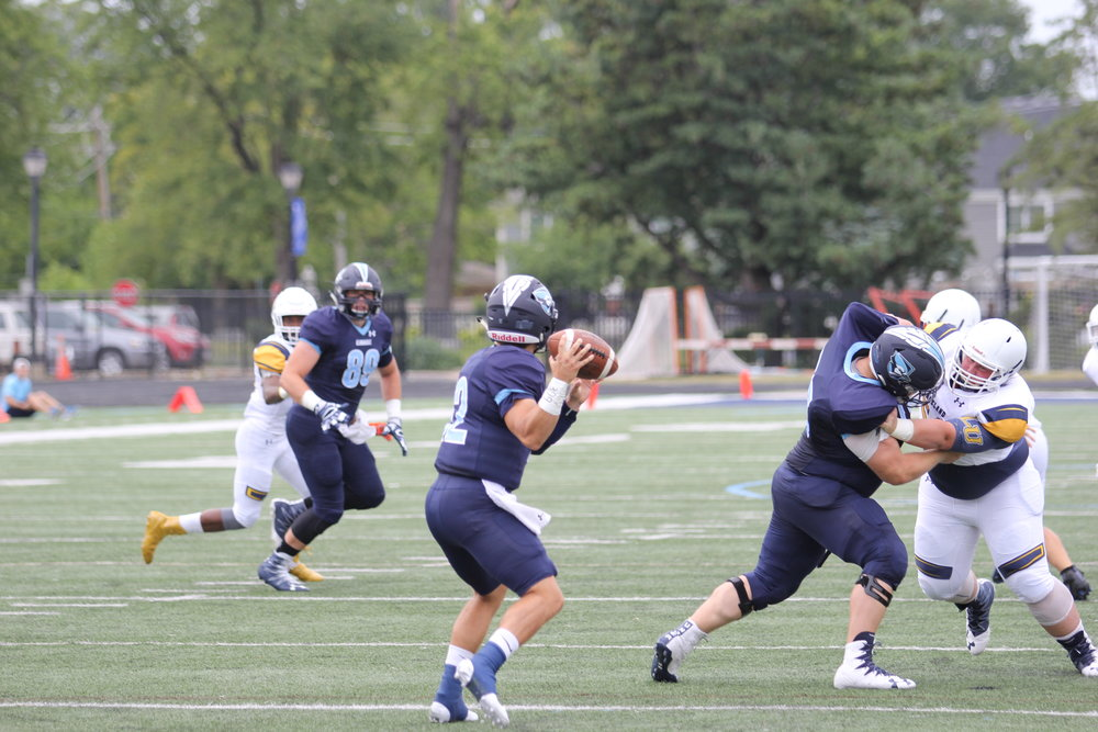 Bluejays quarterback Orlando Hernandez looks for tight end Matt Brachmann over the middle against Lakeland College last weekend.