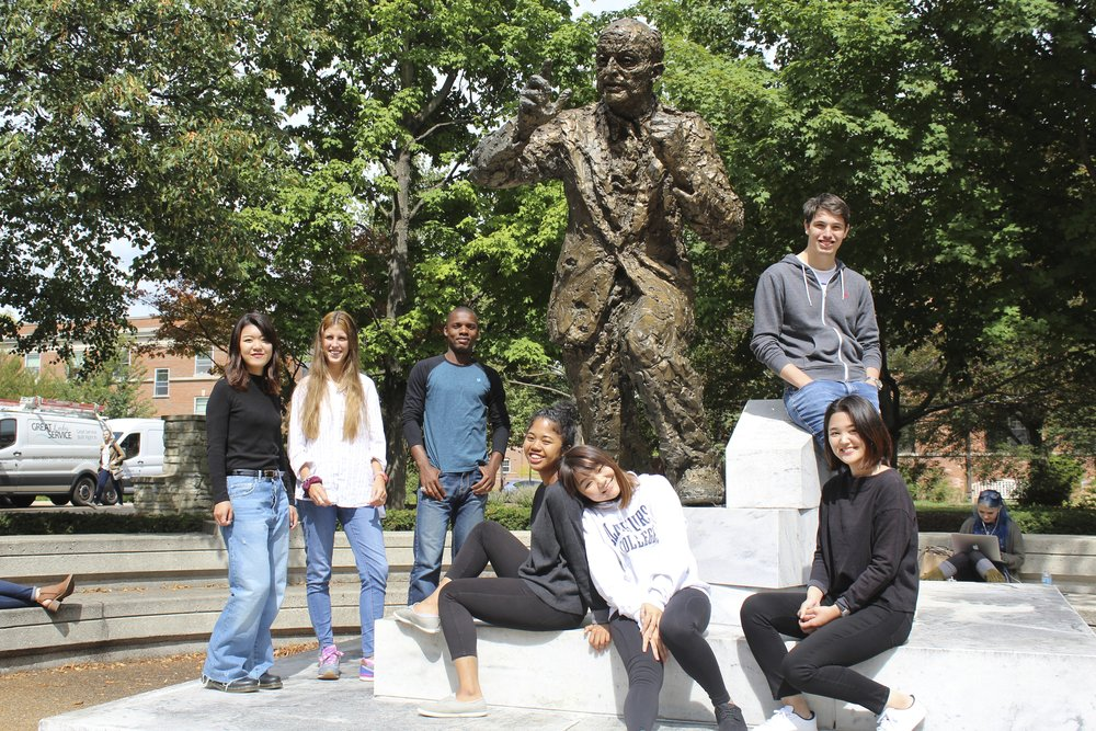 EC international students Rino Matsumura (Japan), Sofia Santin  (Uruguay),Franck KoKo (Cote D'Ivoire), Affy Nakatani (Japan), Betty Shen (Taiwan), Yuki Kajihara (Japan) and Lukas Zeilerbauer (Austria), pose for a picture on the Niebuhr statue on Thursday, Sept 7.  Photo by Abby Robb