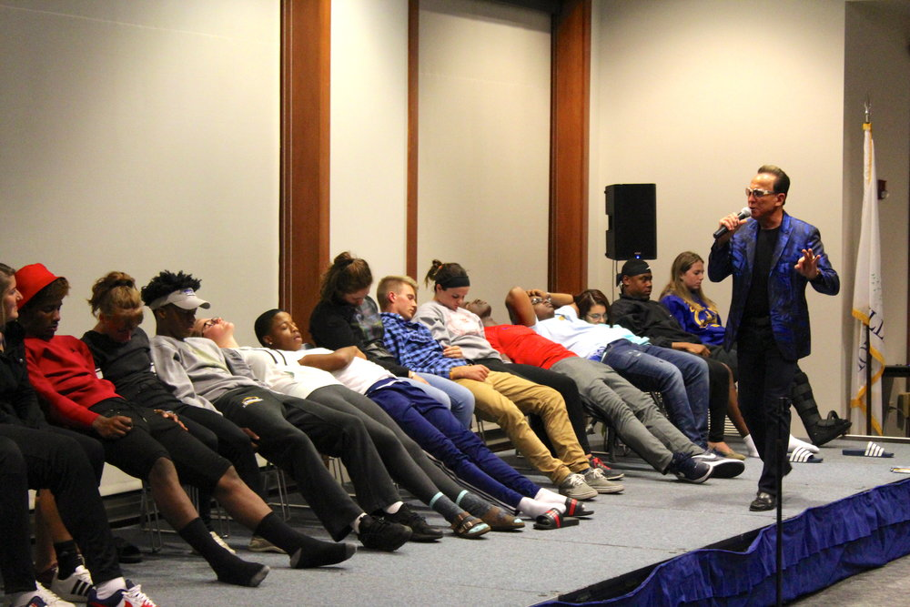 Hypnotist Jim Wand puts student volunteers in a trance at his show in Founder's Lounge on Wednesday, Sept. 6.  Photo by  Abby Robb