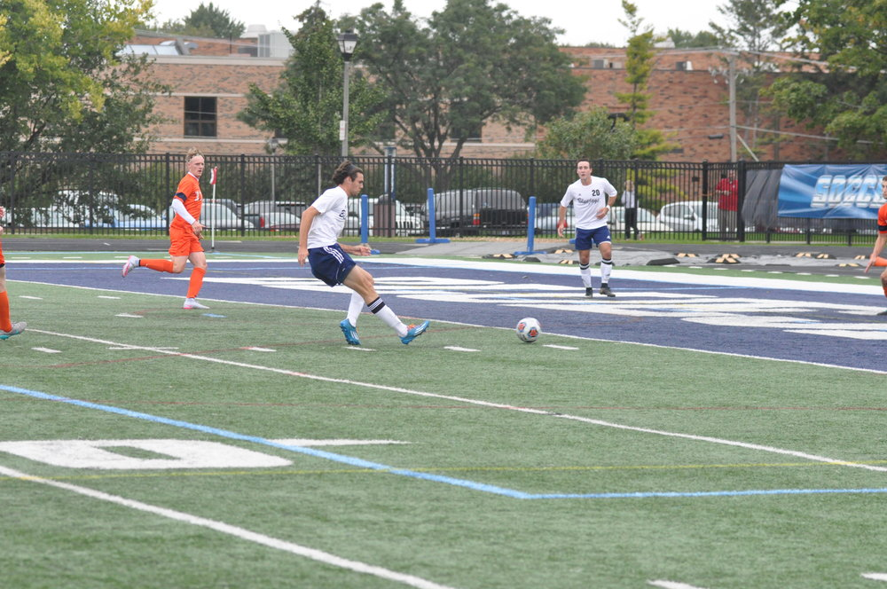 A Bluejay striker approaches the net with a teammate in sight at Langhorst Field.  File Photo