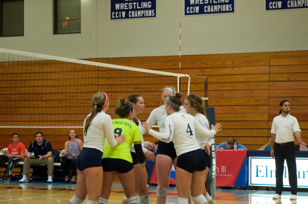 EC volleyball players celebrate a point during their match in Faganel Hall on Sept. 19.  Photo by Lauren Vana