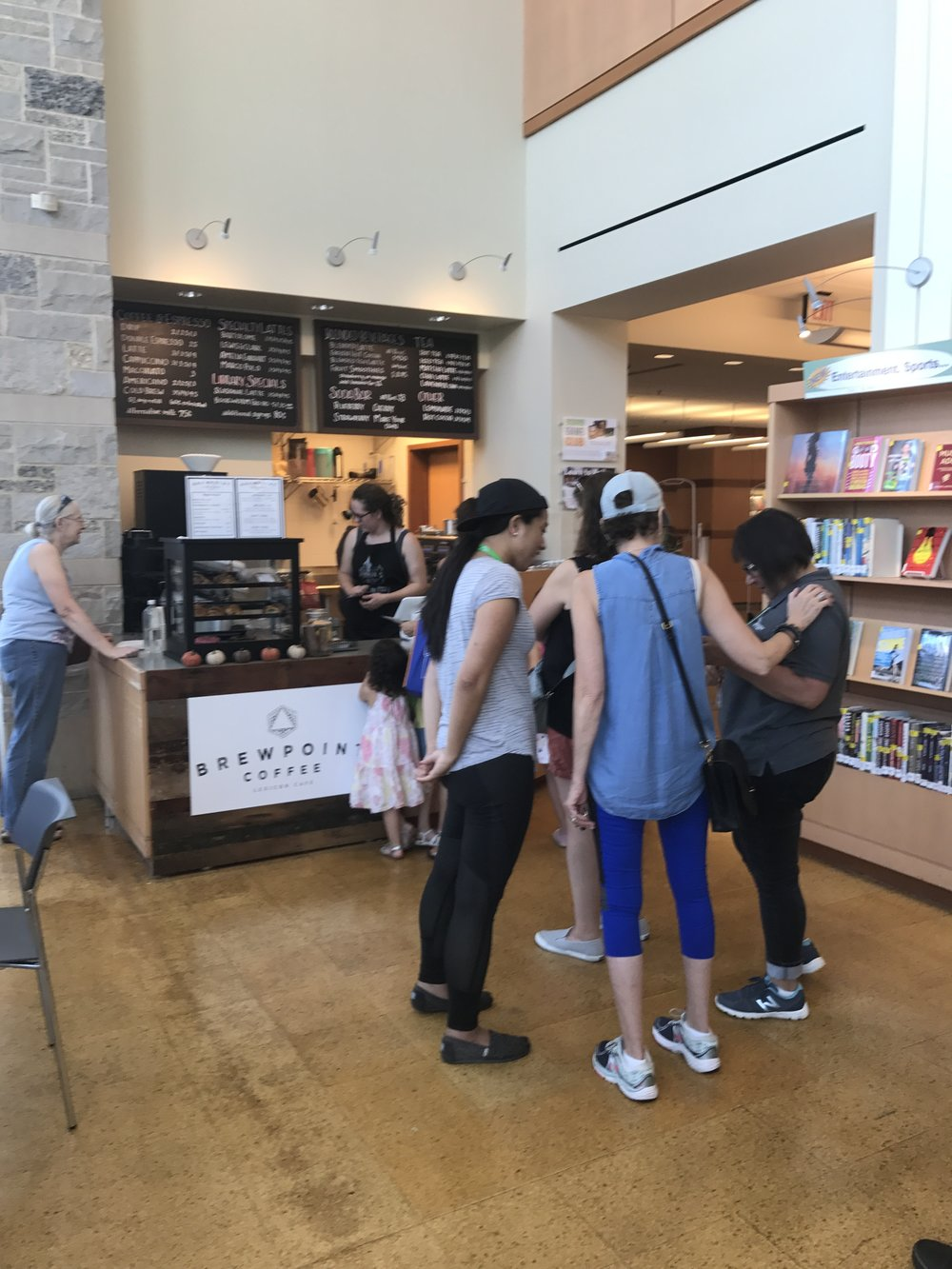Patrons line up to get their morning coffee on Saturday, Sept. 23 at Brewpoint's new location inside the Elmhurst Public Library.  Photo by Estrella Vargas