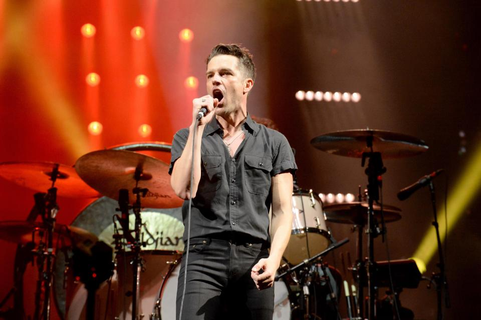The Killer's lead singer Brandon Flowers performs on stage at the Newcastle Metro Arena.  Internet Photo
