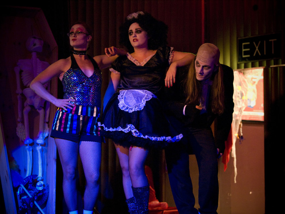 "Fans dress up as famous characters Columbia, Magenta, and Riff Raff (right to left) at a midnight showing of the cult classic film ""The Rocky Horror Picture Show"".  Internet photo"