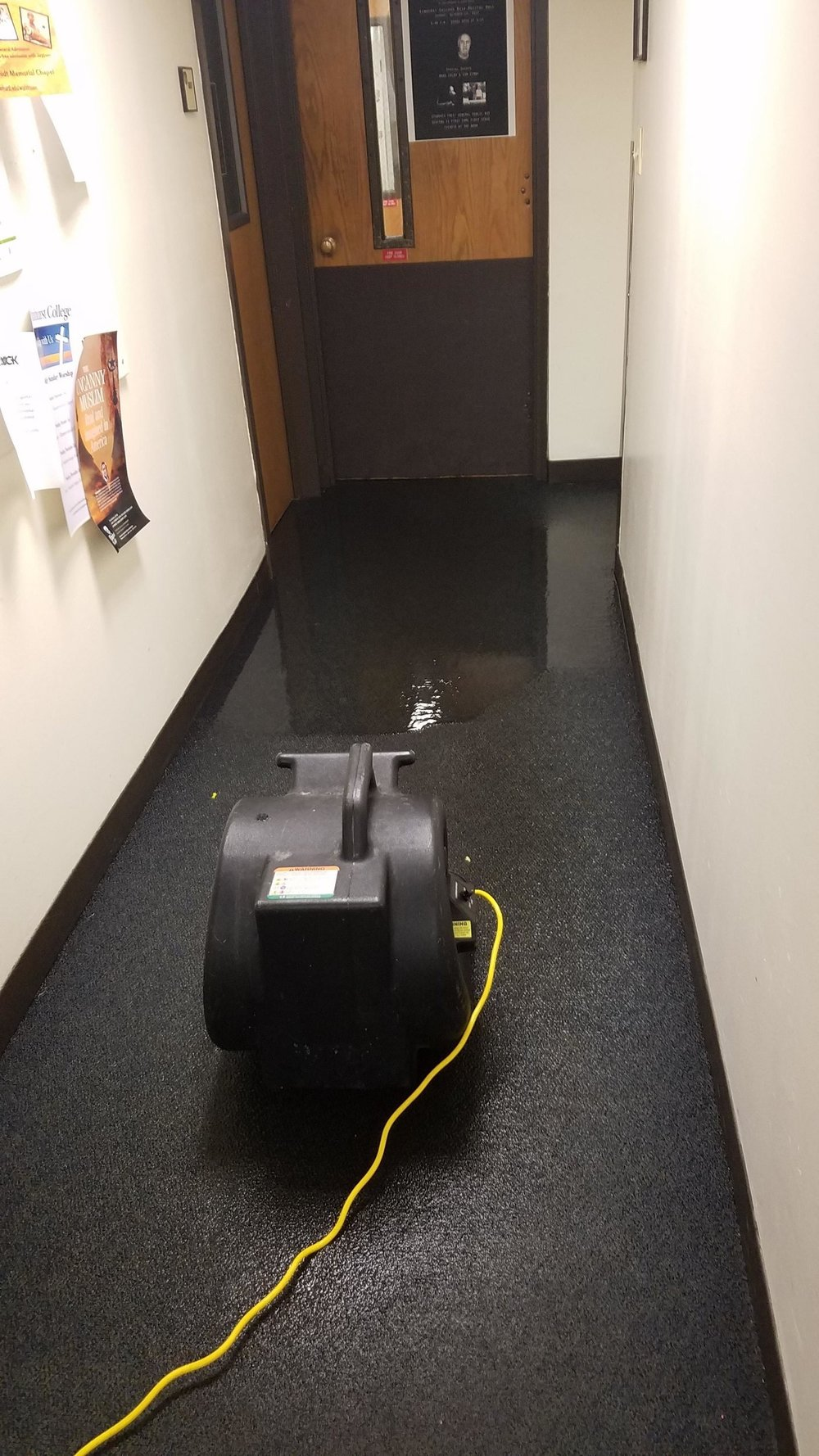 Facilities responds to flooding by placing fans in Irion Hall on Saturday, Oct. 14; pushing water back into the already flooded sections of the basement. Photo courtesy of  Emma Kaminski
