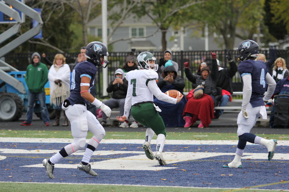 Illinois Wesleyan quarterback Brandon Bauer scores a rushing touchdown late in the second half against the Bluejays  at Langhorst Field. Photo by Cole Sheeks