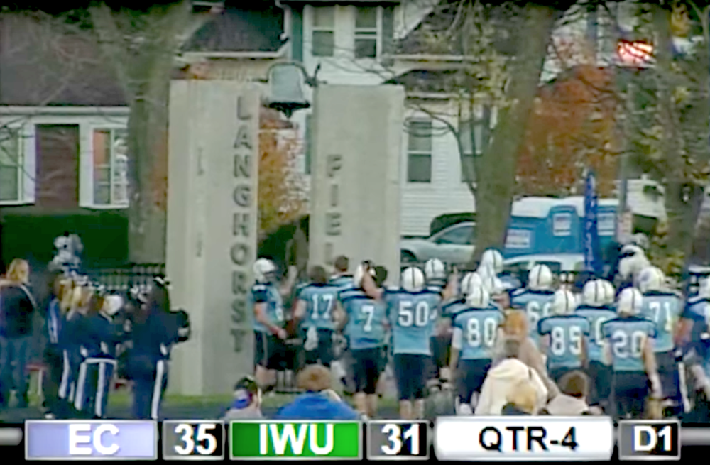 The 2012 EC football team celebrates their CCIW conference championship win by ringing the bell at Langhorst field, their championship win is now forfeited as a result of EC's financial aid infractions.  Internet photo