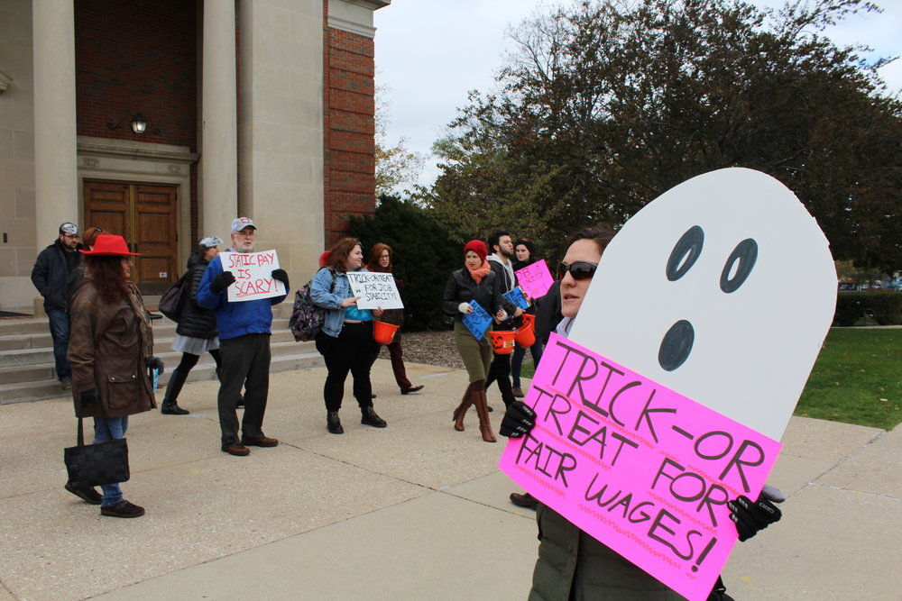 Photo by Abby Robb Costumed protesters gather in front of Hammerschmidt Chapel on Oct. 31 to advocate for a non-tenure faculty union.
