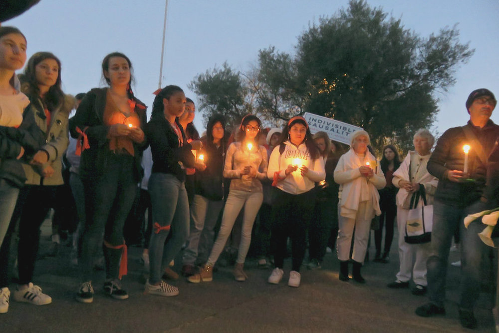 Students at Tam high school hold a candle light vigil for the victims of the Parkland shooting.  Internet Photo