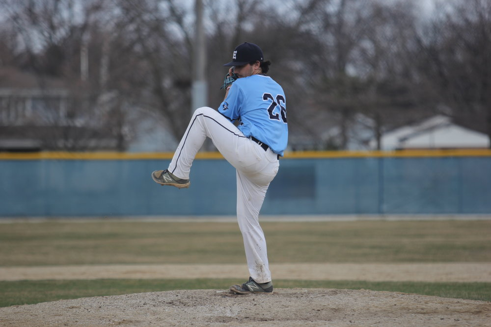 Photo by Cole Sheeks   Sophomore right hander Kevin Johlie throws a pitch during the Bluejays game against IWU at Butterfield Park on March 31.