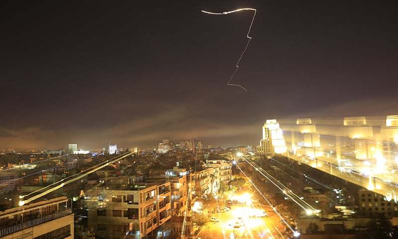 Missiles fly over the Syrian capital of Demascus in the early morning of Saturday, April 14.  Internet Photo