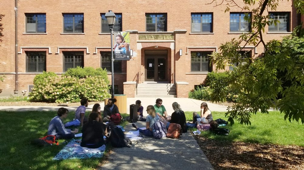 Students sit-out in front of Irion Hall protesting alleged sexual harassment. Photo by Cheyenne Roper