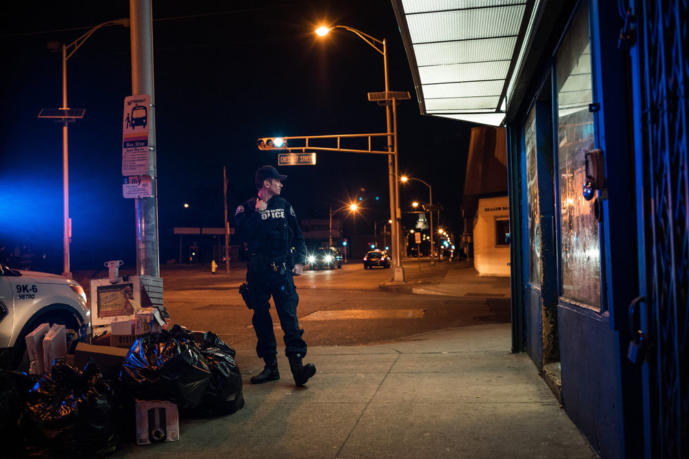 Officer Dennis Smarth on a Camden corner where drug activity has been common. Credit Todd Heisler/The New York Times