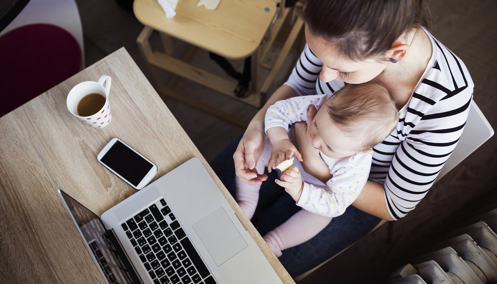 bigstock-Young-mother-working-from-home-89064869.jpg