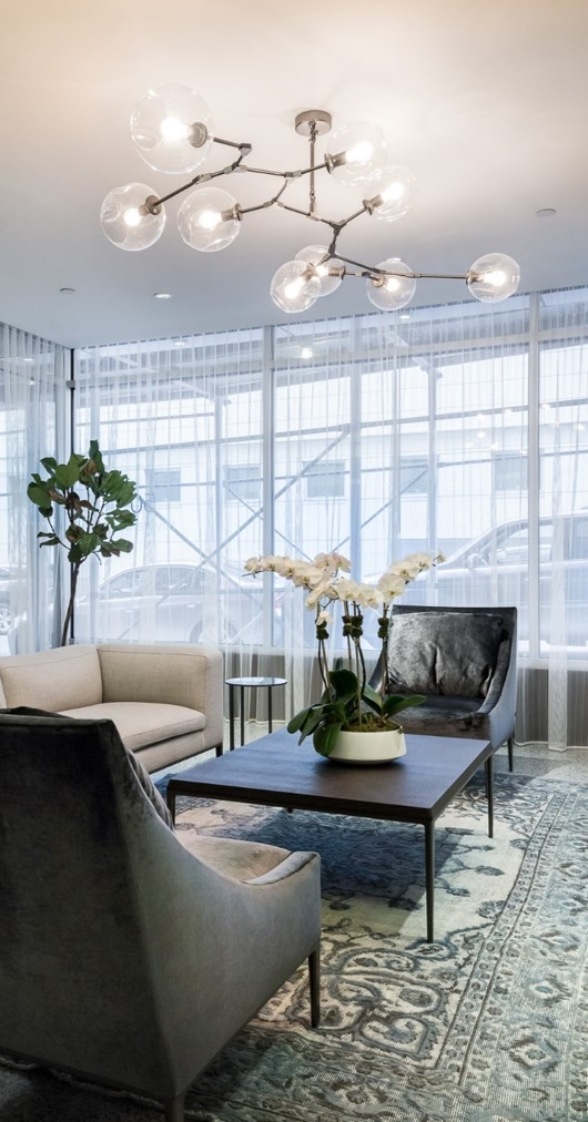Vintage or over dyed rugs are great with modern furniture to create a sophisticated look. In this TriBeCa Lobby we mixed sleek modern furniture with a vintage rug to add sophistication and character to the space.