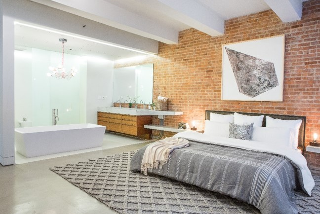 In this Soho loft a chunky rug adds dimension to a monochromatic room