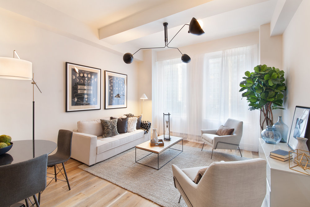 Apartment size furniture and a light color palette makes add a spacious feel of this living room