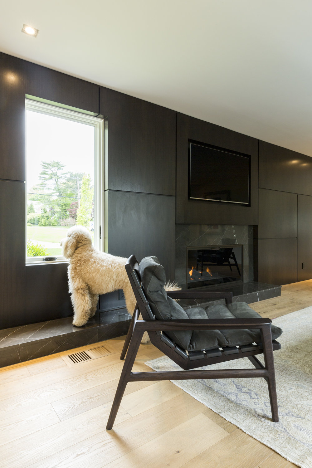 Dark colors and a structural design come together perfectly in this modern living area.