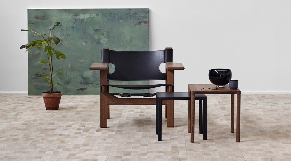 The Spanish Chair  by  Børge Mogensen  is made with solid oak and saddle leather.