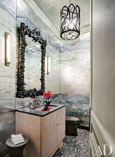 It may look like a mermaid's dream but this powder room is actually located in a Manhattan home, designed by Michael S. Smith and featuring a lantern by  Paul Marra Design