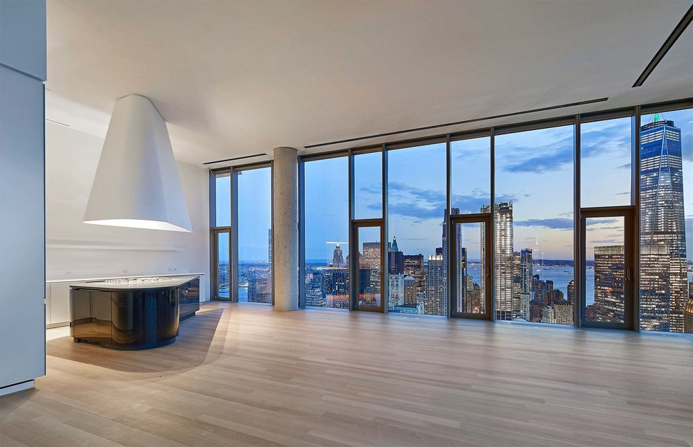 The penthouse kitchens feature a Herzog & de Meuron custom-designed grand piano-shaped island and a custom-sculpted range hood.