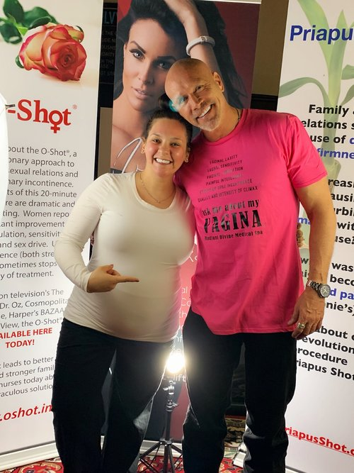 CNP Provider Kyla Westrick with Dr.Charles Runels in one of our awesome t shirts!