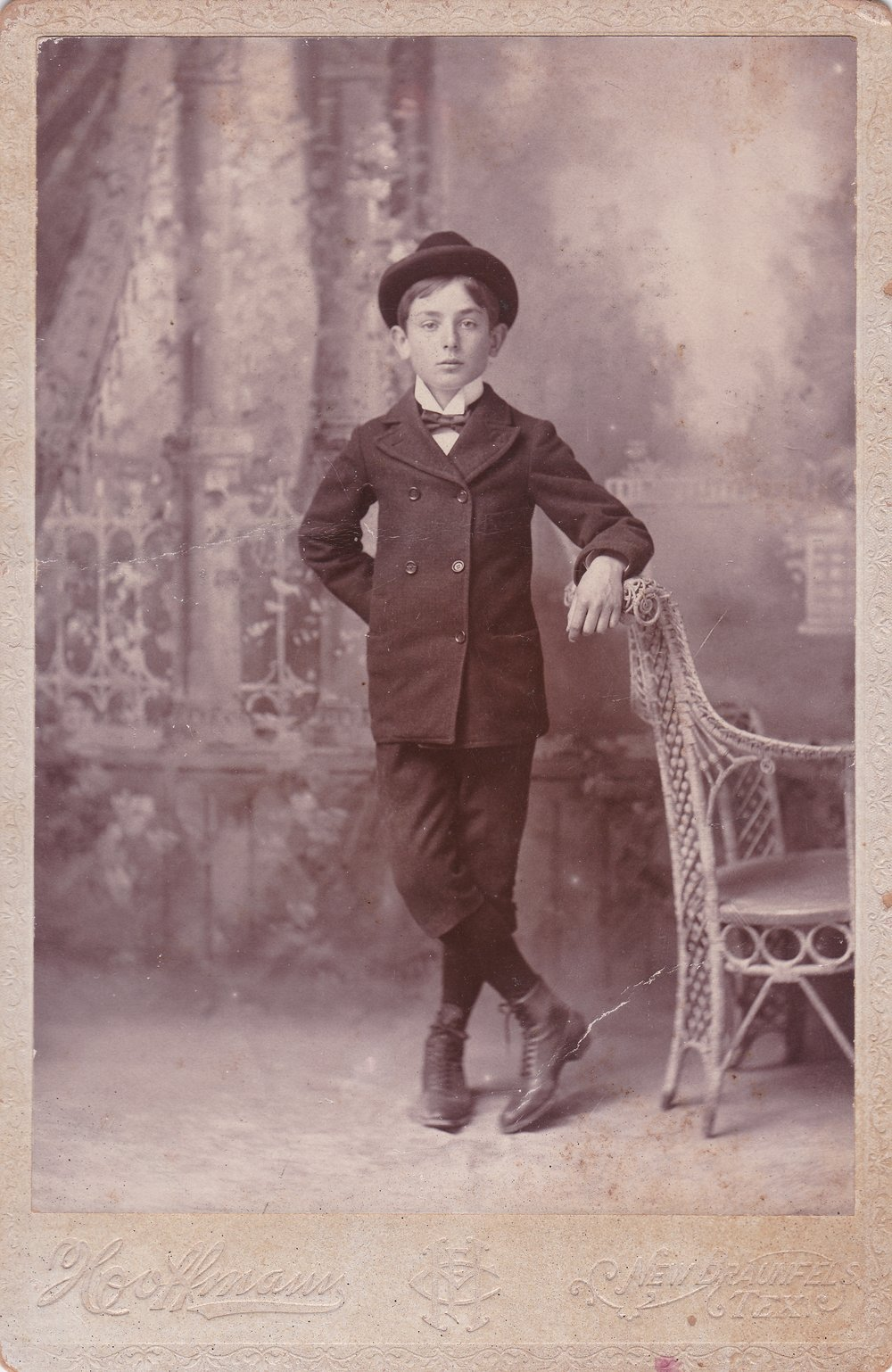 Vintage photo that I picked up at an antique fair of a boy wearing a hat.