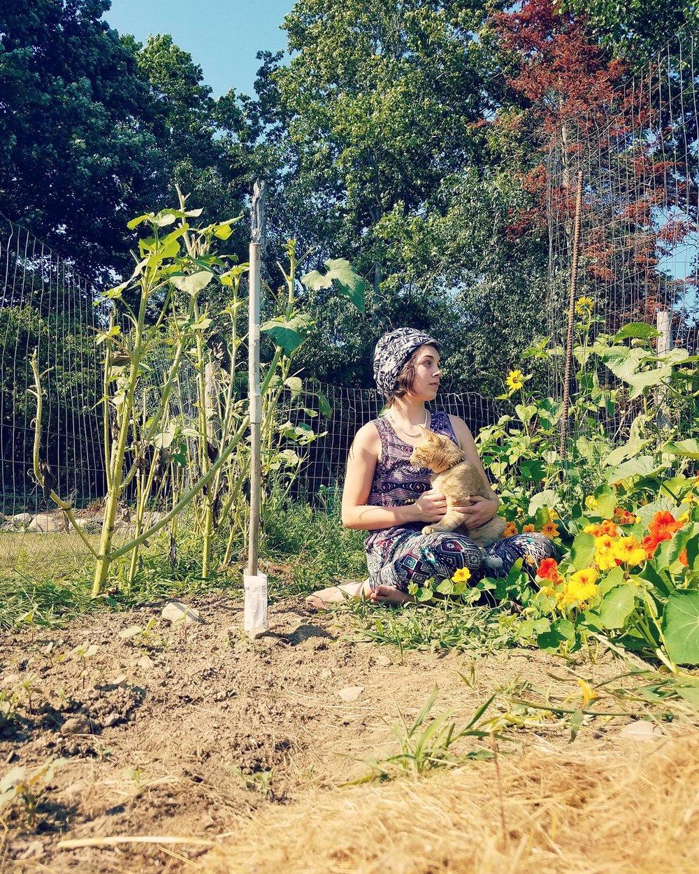Marina in a garden with kitty .jpg