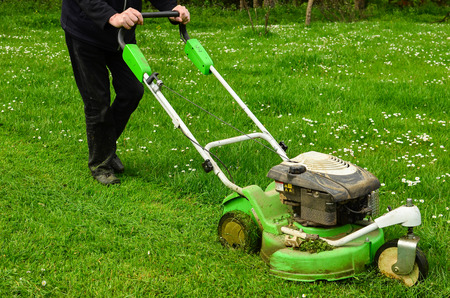 30121309_S_mower_man_walking_grass_cutting.jpg
