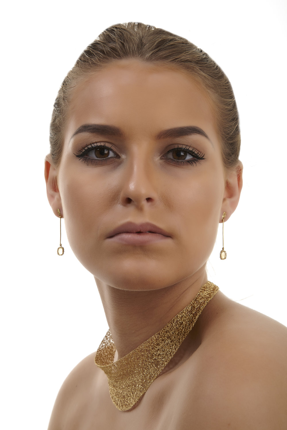 Rina Tiro gold earrings and necklace on model
