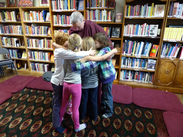 Lama Pema and Dharma Kids hug 2016.jpg