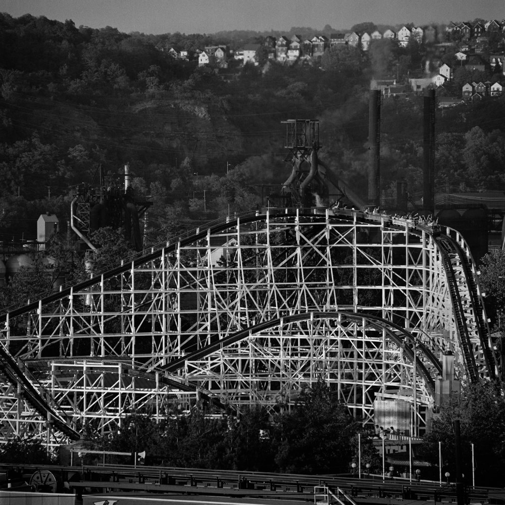 "Lot 07 Mark Perrott, Pittsburgh, PA    Kennywood Thunderbolt 1988 , 1988, Archival ink on Hahnemuhle Photo Rag, 36"" x 36"" Donated by the artist Signed, verso $ 2,000 - 3,200   markperrott.com"