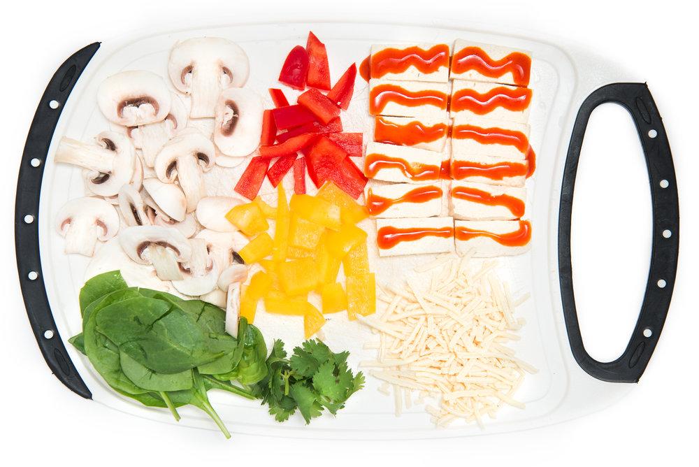 Step 2: Slice Mushrooms, red & yellow peppers, tofu marinated in sriracha, baby spinach, cilantro and Vegan Mozzarella cheeze
