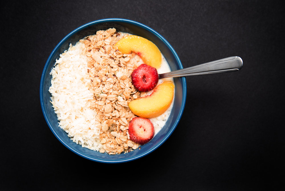 Oatmeal, coconut shreds, granola mix and fruits