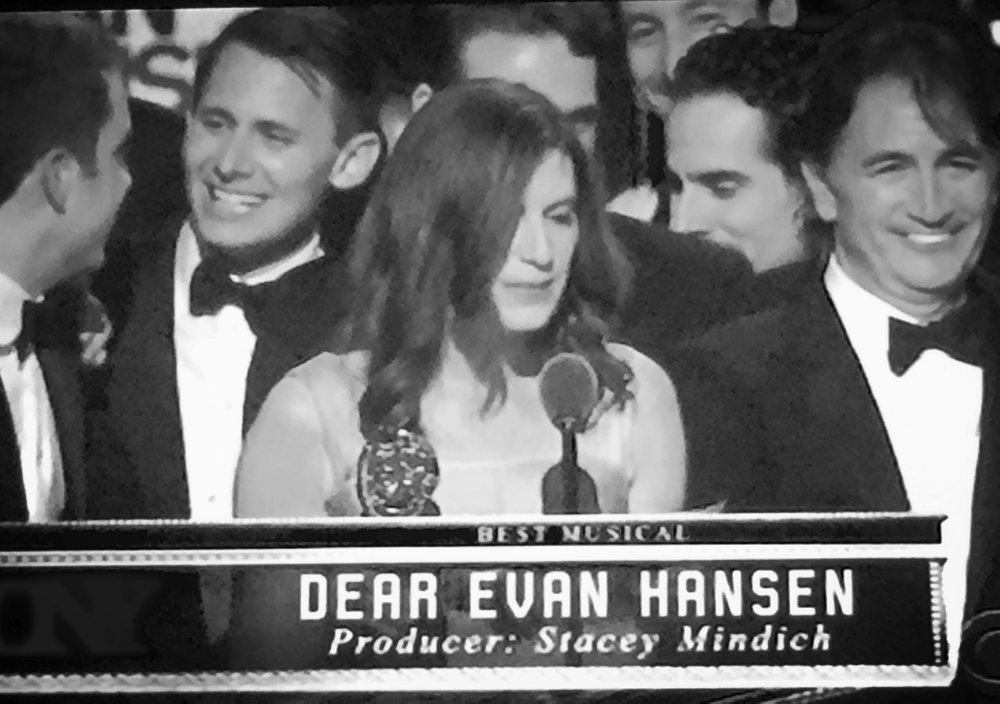 Stacey Mindich accepted the Tony for Best Musical surrounded by Dear Evan Hansen family.