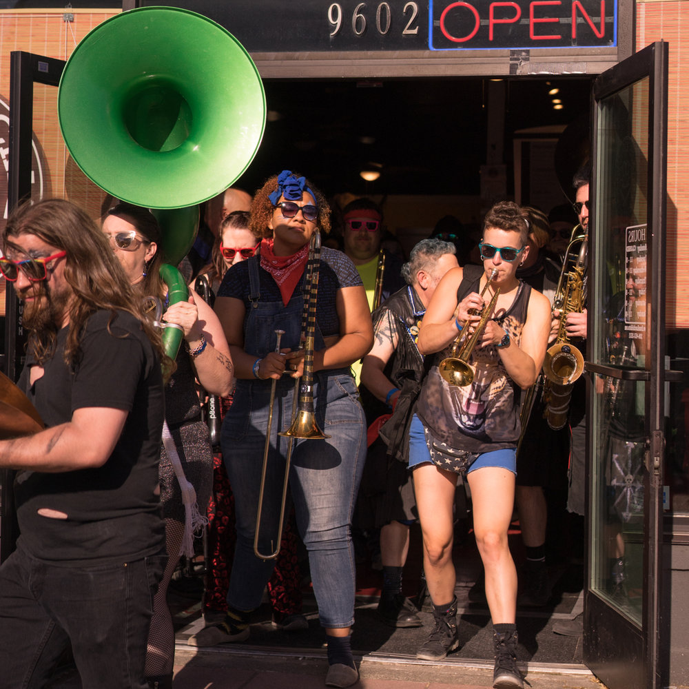 Brass Band exiting Brass Knuckles Bistro