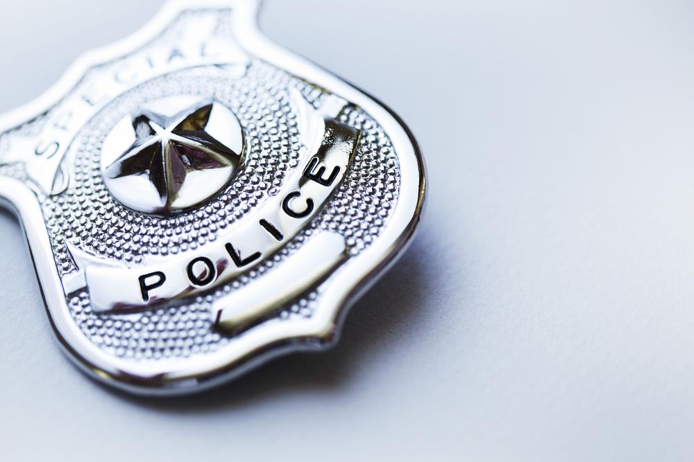 shutterstock_482810731 police badge.jpg