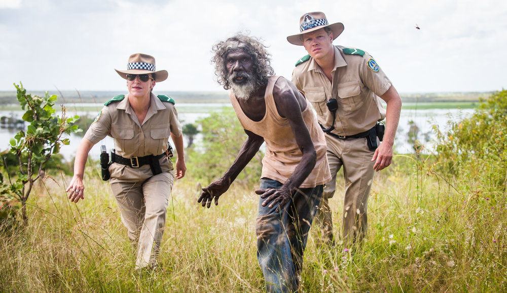 35_CCA0729 - Charlie (David Gulpilil, C) leads the police (Fiona Lanyon, L, and Luke Ford, R) copy.jpg