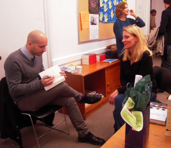 Chris Castellani signing a book for Mari Passananti, Sue Miller in the background