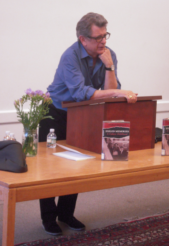 Poet/novelist Pablo Medina answering questions from the SE library's audience