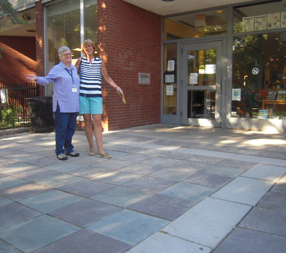 Head librarian Anne Smart and library patron Marian Ellwood love the newly repaired sidewalk