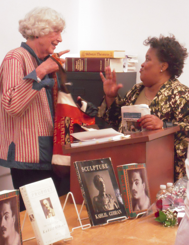 Jean Gibran talks with an admirer at the South End library