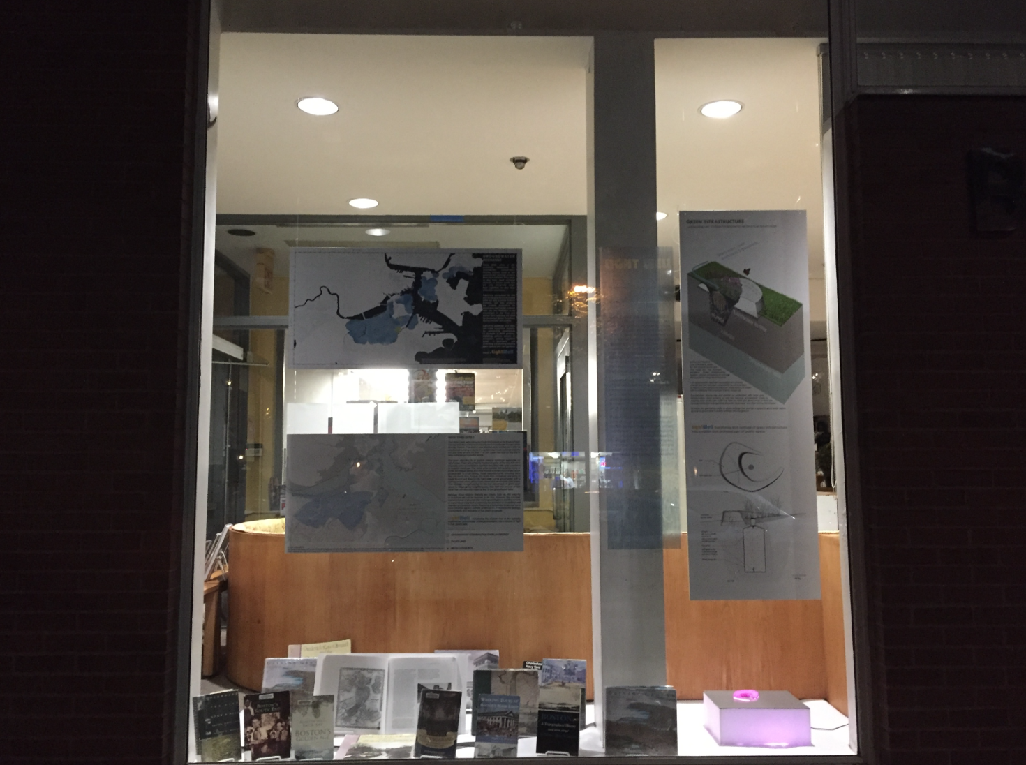 SE library's window display at night, as seen from Tremont Street