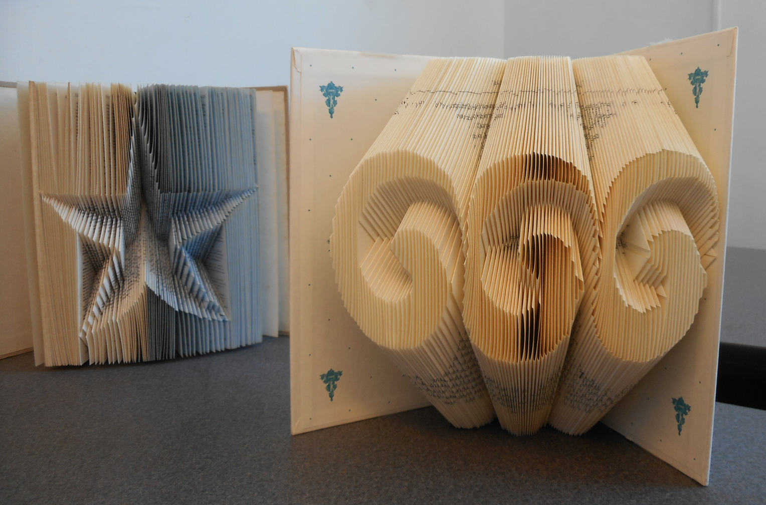 Librarian Veronica Mueller's folded books