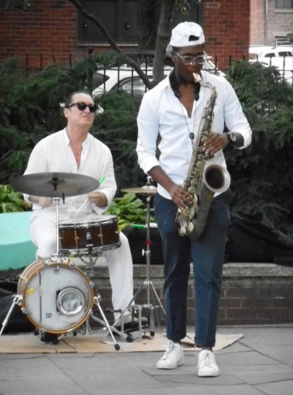 Benny Benson drumming with tenor-sax player Yesseh Ali