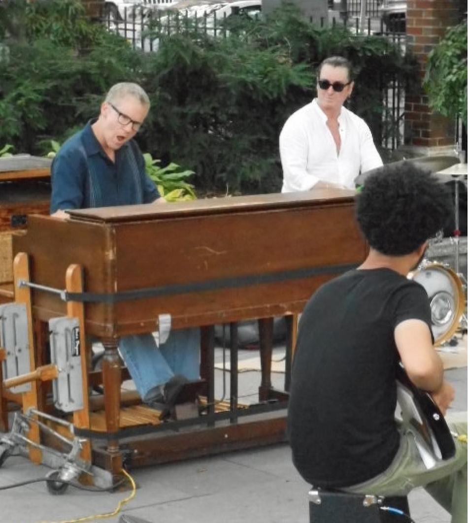 Rusty Scott on organ; Benny Benson, drums; and, from the back Antonio Loomis, guitar