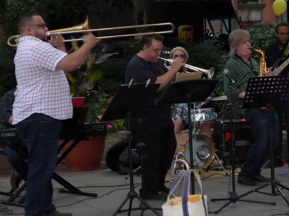 Angel Subero (trombone), Scott Aruda (trumpet) and Pat Loomis (saxophone give it their all