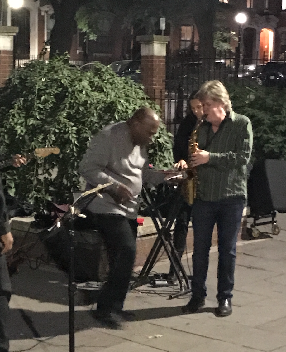 Pat Loomis, saxophone, and his 'walk-on' guest, soul singer Leon Beal, Jr. in Library Park, with Zayra Pola, on percussion, in the background