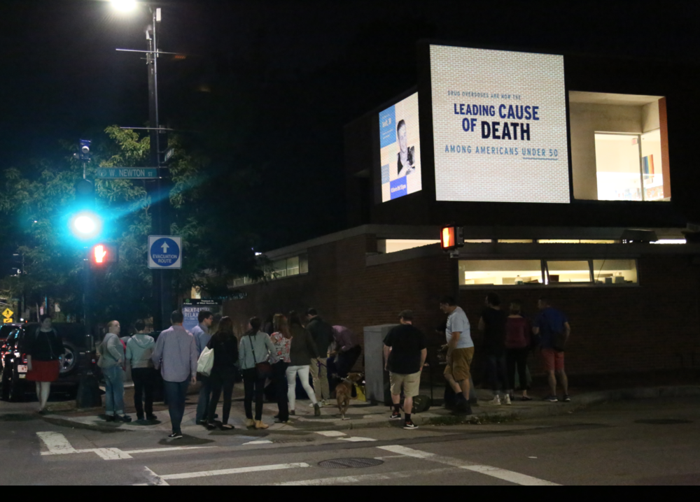 Images representing the urgency of the opioid crisis were projected on the walls of the South End library on the night of Thursday,  August 31